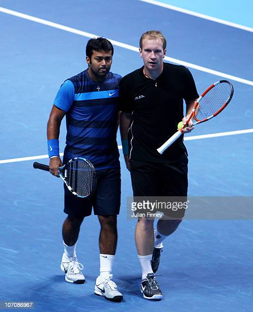 Leander Paes of India and Lukas Dlouhy of Czech Republic walk on the court during their men's doubles match against Jurgen Melzer of Austria and...