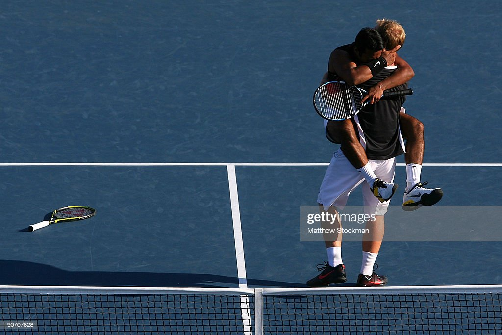 Leander Paes of India and Lukas Dlouhy of the Czech Republic celebrate championship point after defeating Mahesh Bhupathi of India and Mark Knowles...
