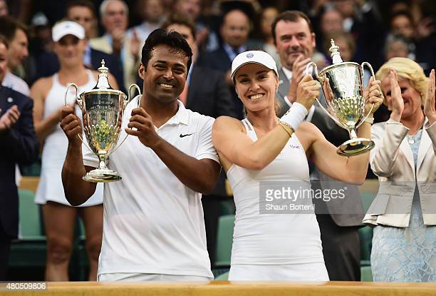 Leander Paes of India and Martina Hingis of Switzerland celebrate with the trophy after winning the Final Of The Mixed Doubles against Timea Babos of...