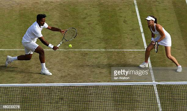 Leander Paes of India and Martina Hingis of Switzerland in action in the Mixed Doubles match against Mike Bryan of the USA and Bethanie MattekSands...