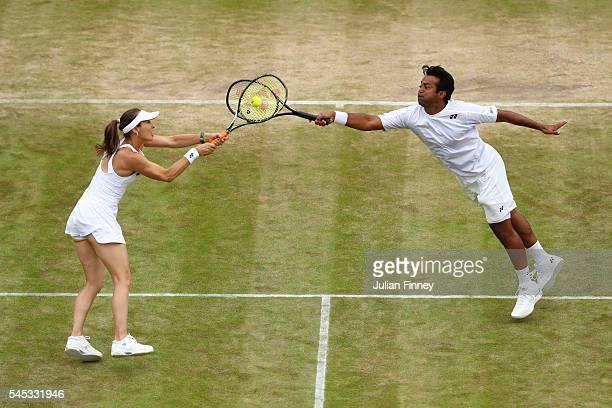 Leander Paes of India and Martina Hingis of Switzerland in acton during the Mixed Doubles third round match against Henri Kontinen of Finland and...