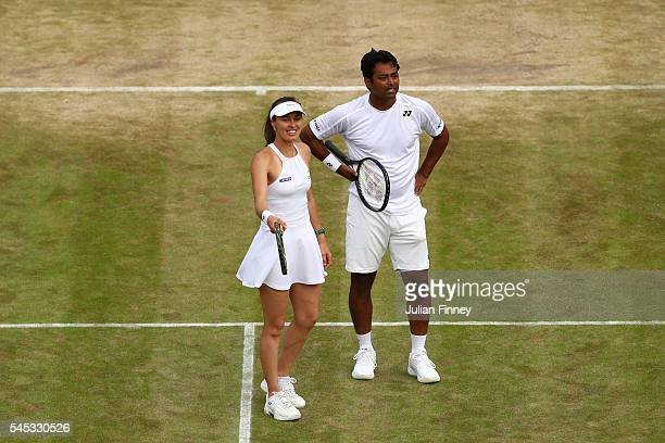 Leander Paes of India and Martina Hingis of Switzerland in conversation during the Mixed Doubles third round match against Henri Kontinen of Finland...