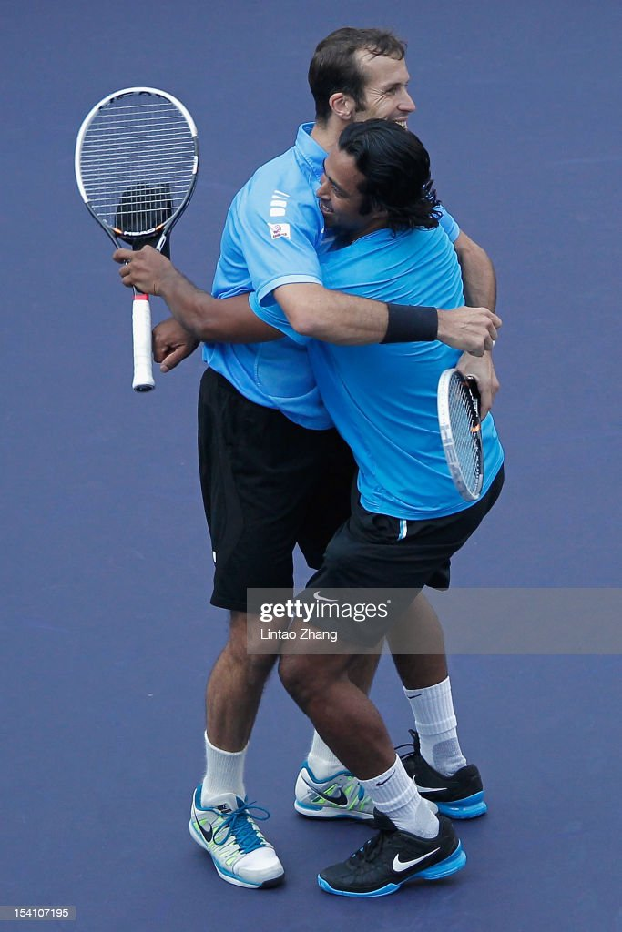 <a gi-track='captionPersonalityLinkClicked' href=/galleries/search?phrase=Leander+Paes&family=editorial&specificpeople=215327 ng-click='$event.stopPropagation()'>Leander Paes</a> of India and <a gi-track='captionPersonalityLinkClicked' href=/galleries/search?phrase=Radek+Stepanek&family=editorial&specificpeople=193842 ng-click='$event.stopPropagation()'>Radek Stepanek</a> (L) of Czech Republic celebrate match point against Mahesh Bhupathi and Rohan Bopanna of India during the doubles final of the Shanghai Rolex Masters at the Qi Zhong Tennis Center on October 14, 2012 in Shanghai, China.