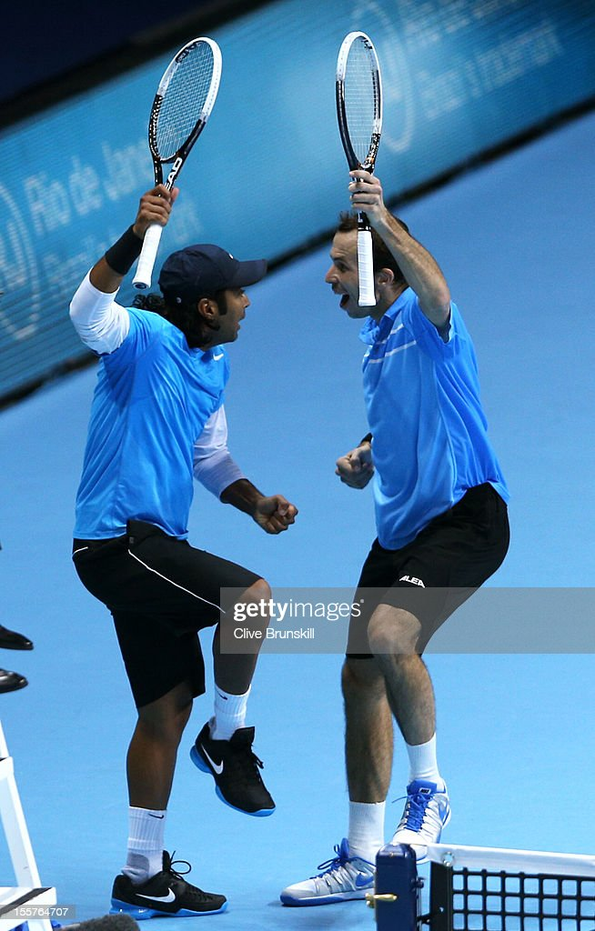 <a gi-track='captionPersonalityLinkClicked' href=/galleries/search?phrase=Leander+Paes&family=editorial&specificpeople=215327 ng-click='$event.stopPropagation()'>Leander Paes</a> of India and <a gi-track='captionPersonalityLinkClicked' href=/galleries/search?phrase=Radek+Stepanek&family=editorial&specificpeople=193842 ng-click='$event.stopPropagation()'>Radek Stepanek</a> of Czech Republic celebrate a point during the men's doubles match against Marcel Granollers of Spain and Marc Lopez of Spain on day four of the ATP World Tour Finals at the O2 Arena on November 8, 2012 in London, England.