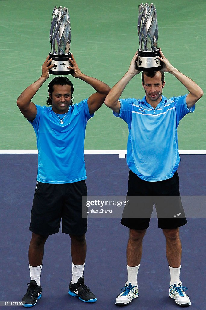 <a gi-track='captionPersonalityLinkClicked' href=/galleries/search?phrase=Leander+Paes&family=editorial&specificpeople=215327 ng-click='$event.stopPropagation()'>Leander Paes</a> of India and <a gi-track='captionPersonalityLinkClicked' href=/galleries/search?phrase=Radek+Stepanek&family=editorial&specificpeople=193842 ng-click='$event.stopPropagation()'>Radek Stepanek</a> of the Czech pose for photographers after defeqating Mahesh Bhupathi and Rohan Bopanna of India during the doubles final of Shanghai Rolex Masters at the Qi Zhong Tennis Center on October 14, 2012 in Shanghai, China.