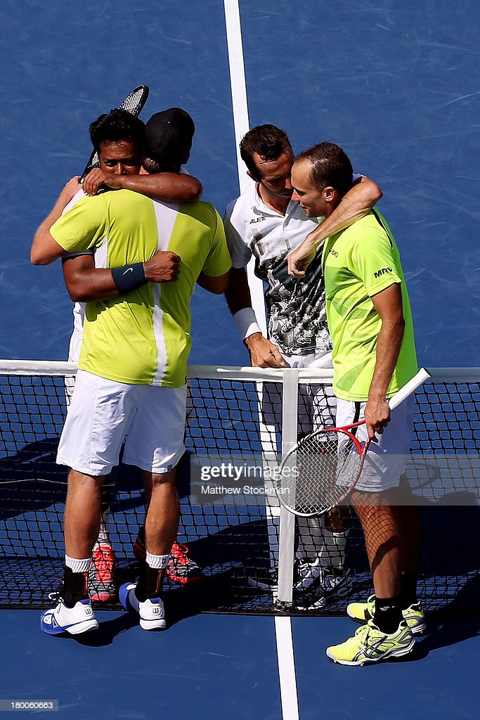 Leander Paes of India and Radek Stepanek of the Czech Republic hug Alexander Peya of Austria and Bruno Soares of Brazil after winning their men's doubles final against on Day Fourteen of the 2013 US Open at the USTA Billie Jean King National Tennis Center on September 8, 2013 in the Flushing neighborhood of the Queens borough of New York City. Paes and Stepanek defeated Peya and Soares 6-1 6-3.