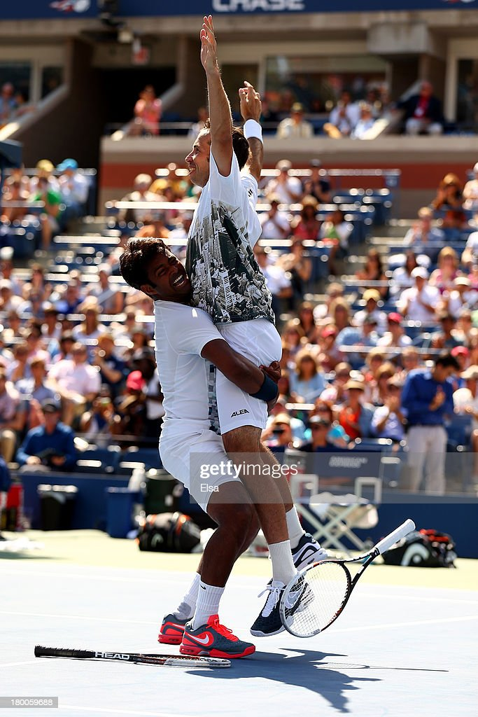 Leander Paes (L) of India and Radek Stepanek (R) of the Czech Republic celebrate winning their men's doubles final against Alexander Peya of Austria and Bruno Soares of Brazil on Day Fourteen of the 2013 US Open at the USTA Billie Jean King National Tennis Center on September 8, 2013 in the Flushing neighborhood of the Queens borough of New York City. Paes and Stepanek defeated Peya and Soares 6-1 6-3.