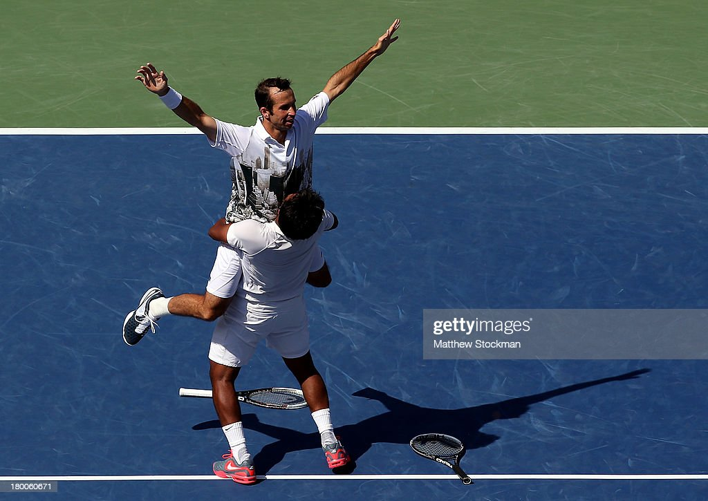<a gi-track='captionPersonalityLinkClicked' href=/galleries/search?phrase=Leander+Paes&family=editorial&specificpeople=215327 ng-click='$event.stopPropagation()'>Leander Paes</a> (R) of India and <a gi-track='captionPersonalityLinkClicked' href=/galleries/search?phrase=Radek+Stepanek&family=editorial&specificpeople=193842 ng-click='$event.stopPropagation()'>Radek Stepanek</a> (L) of the Czech Republic celebrate winning their men's doubles final against Alexander Peya of Austria and Bruno Soares of Brazil on Day Fourteen of the 2013 US Open at the USTA Billie Jean King National Tennis Center on September 8, 2013 in the Flushing neighborhood of the Queens borough of New York City. Paes and Stepanek defeated Peya and Soares 6-1 6-3.