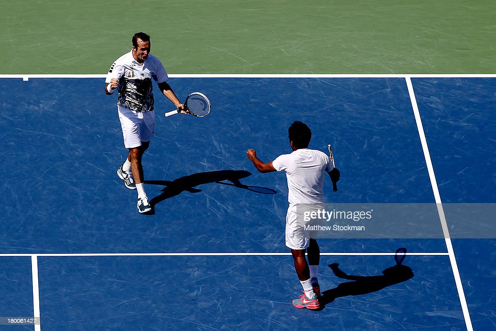 Leander Paes of India and Radek Stepanek of the Czech Republic celebrate winning their men's doubles final against Alexander Peya of Austria and Bruno Soares of Brazil on Day Fourteen of the 2013 US Open at the USTA Billie Jean King National Tennis Center on September 8, 2013 in the Flushing neighborhood of the Queens borough of New York City. Paes and Stepanek defeated Peya and Soares 6-1 6-3.