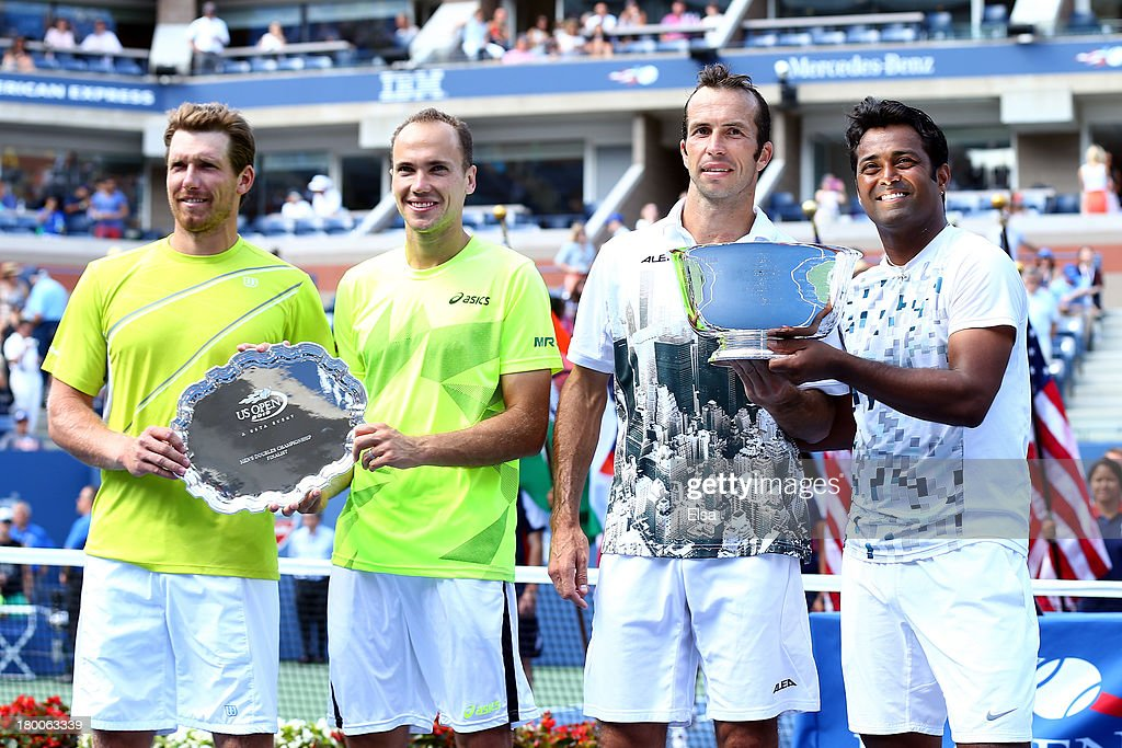 Leander Paes (R) of India and Radek Stepanek (2nd R) of the Czech Republic pose with their trophy next to Alexander Peya (L) of Austria and Bruno Soares (2nd L) of Brazil after winning their men's doubles final on Day Fourteen of the 2013 US Open at the USTA Billie Jean King National Tennis Center on September 8, 2013 in the Flushing neighborhood of the Queens borough of New York City. Paes and Stepanek defeated Peya and Soares 6-1 6-3.