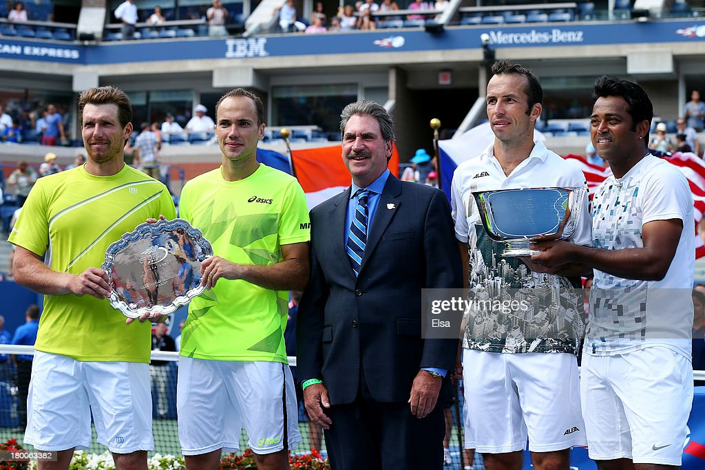 Leander Paes (R) of India and Radek Stepanek (2nd R) of the Czech Republic pose with their trophy next to Alexander Peya (L) of Austria, Bruno Soares (2nd L) of Brazil and First Vice President of the United States Tennis Association David Haggerty (C) after winning their men's doubles final on Day Fourteen of the 2013 US Open at the USTA Billie Jean King National Tennis Center on September 8, 2013 in the Flushing neighborhood of the Queens borough of New York City. Paes and Stepanek defeated Peya and Soares 6-1 6-3.