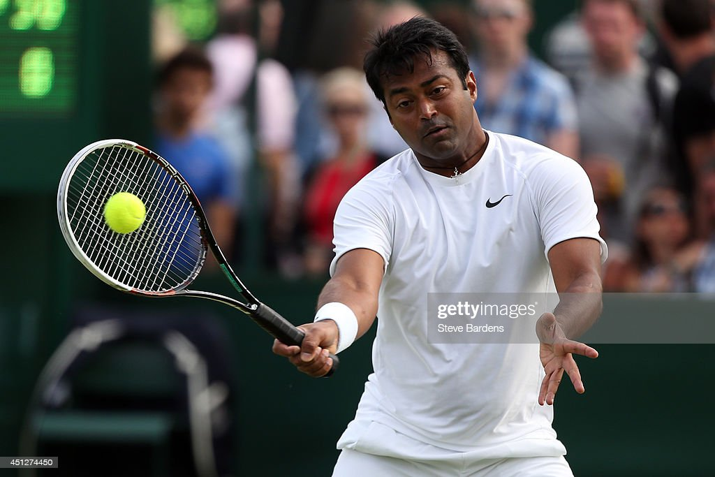 <a gi-track='captionPersonalityLinkClicked' href=/galleries/search?phrase=Leander+Paes&family=editorial&specificpeople=215327 ng-click='$event.stopPropagation()'>Leander Paes</a> of India during his Gentlemen's Doubles first round match with Radek Stepanek of Czech Republic against Mariusz Fyrstenberg of Poland and Rajeev Ram of the United States on day four of the Wimbledon Lawn Tennis Championships at the All England Lawn Tennis and Croquet Club at Wimbledon on June 26, 2014 in London, England.