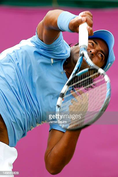 Leander Paes of India serves next to his partner Vishnu Vardhan of India during the Men's Doubles Tennis match against JeanJulien Rojer of...