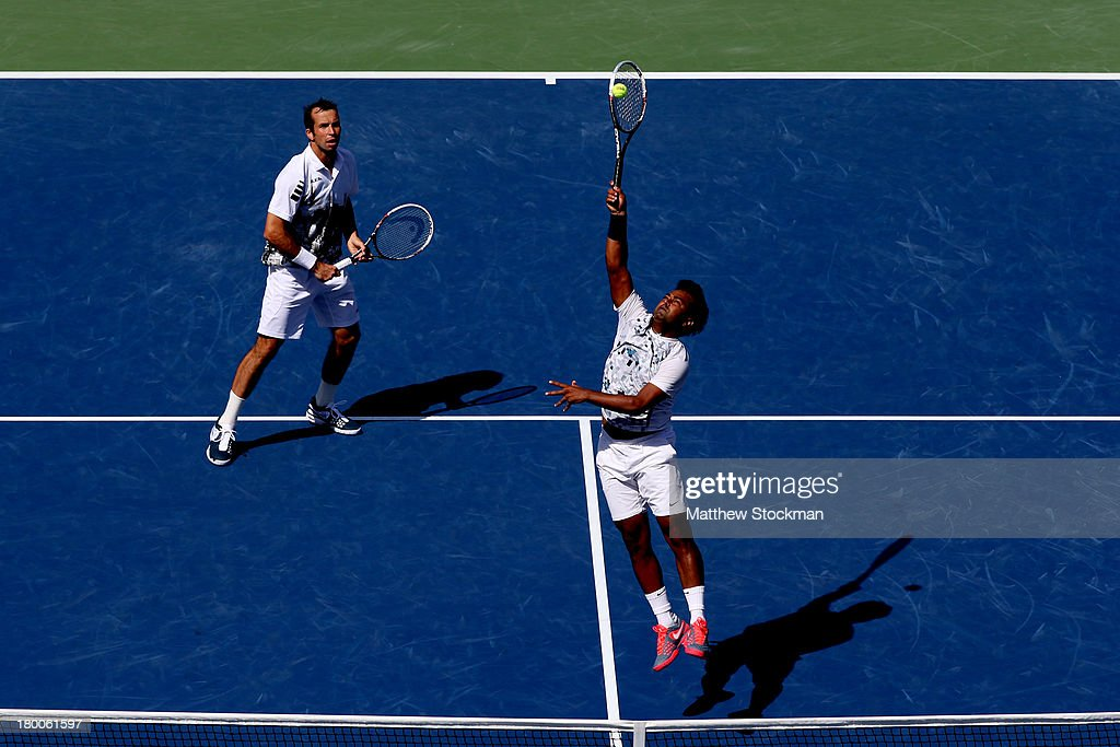 Leander Paes of India smashes the ball next to his partner Radek Stepanek of Czech Republic during their men's doubles final against Alexander Peya of Austria and Bruno Soares of Brazil on Day Fourteen of the 2013 US Open at the USTA Billie Jean King National Tennis Center on September 8, 2013 in the Flushing neighborhood of the Queens borough of New York City. Paes and Stepanek defeated Peya and Soares 6-1 6-3.