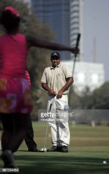 Leander Paes prepares to take a shot at the Wellington Golf Course