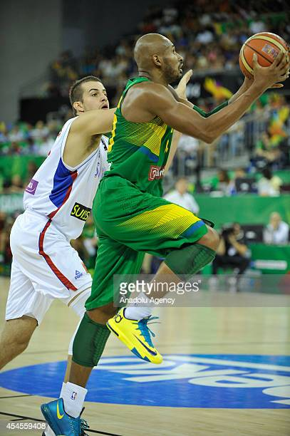 Leandrinho Barbosa of Brazil in action against Nemanja Bjelica of Serbia during the 2014 FIBA Basketball World Cup Group A match between Serbia and...