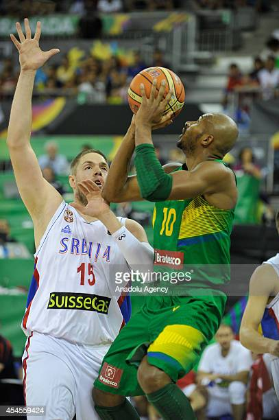 Leandrinho Barbosa of Brazil in action against Vladimir Stimac during the 2014 FIBA Basketball World Cup Group A match between Serbia and Brazil at...