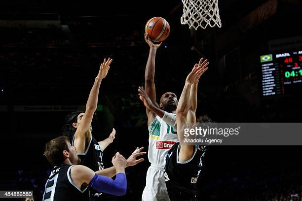 Leandrinho Barbosa of Brazil vies with Andres Nocioni Luis Scola and Nicolas Laprovittola of Argentina during FIBA Basketball World Cup 2014 match...