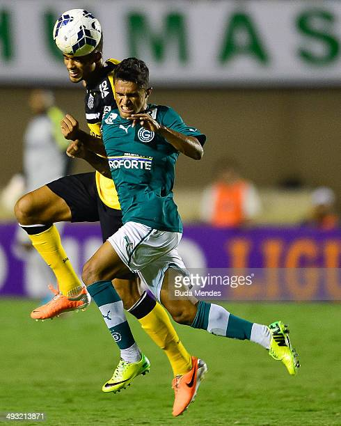 Leandrinho of Santos struggles for the ball with Lima of Goias during a match between Goias and Santos as part of Brasileirao Series A 2014 at Serra...