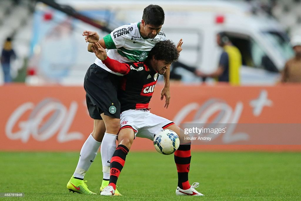 Leandro Almeida of Coritiba competes for the ball with Arthur of Flamengo during the match between Coritiba and Flamengo for the Brazilian Series A 2014 at Couto Pereira stadium on August 17, 2014 in Curitiba, Brazil.