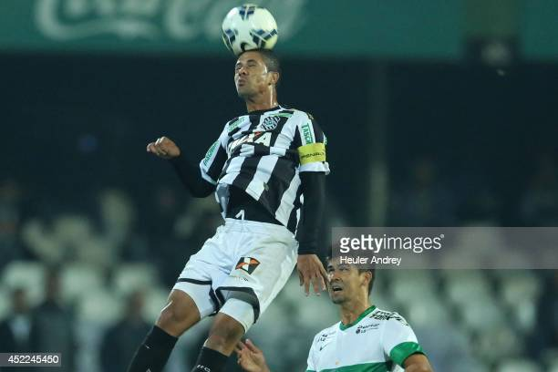 Leandro Almeida of Coritiba competes for the ball with Ricardo Bueno of Figueirense during the match between Coritiba and Figueirense for the...