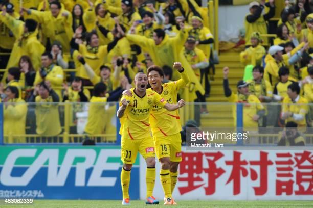 Leandro and Junya Tanaka of Kashiwa Reysol celebrate the second goal during the JLeague match between Kashiwa Reysol and Cerezo Osaka at Hitachi...