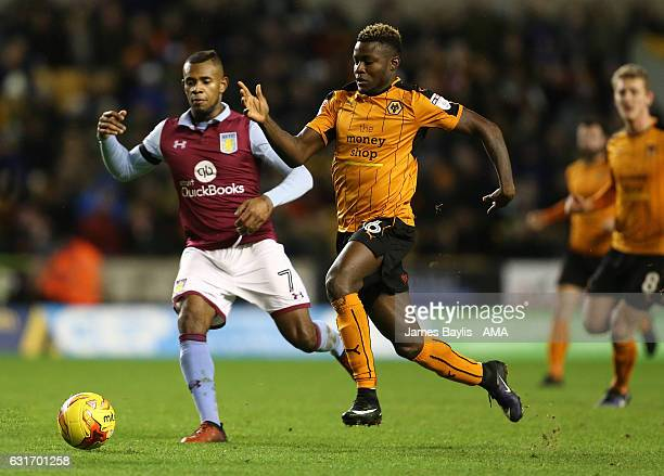 Leandro Bacuna of Aston Villa and Bright Enobakhare of Wolverhampton Wanderers during the Sky Bet Championship match between Wolverhampton Wanderers...