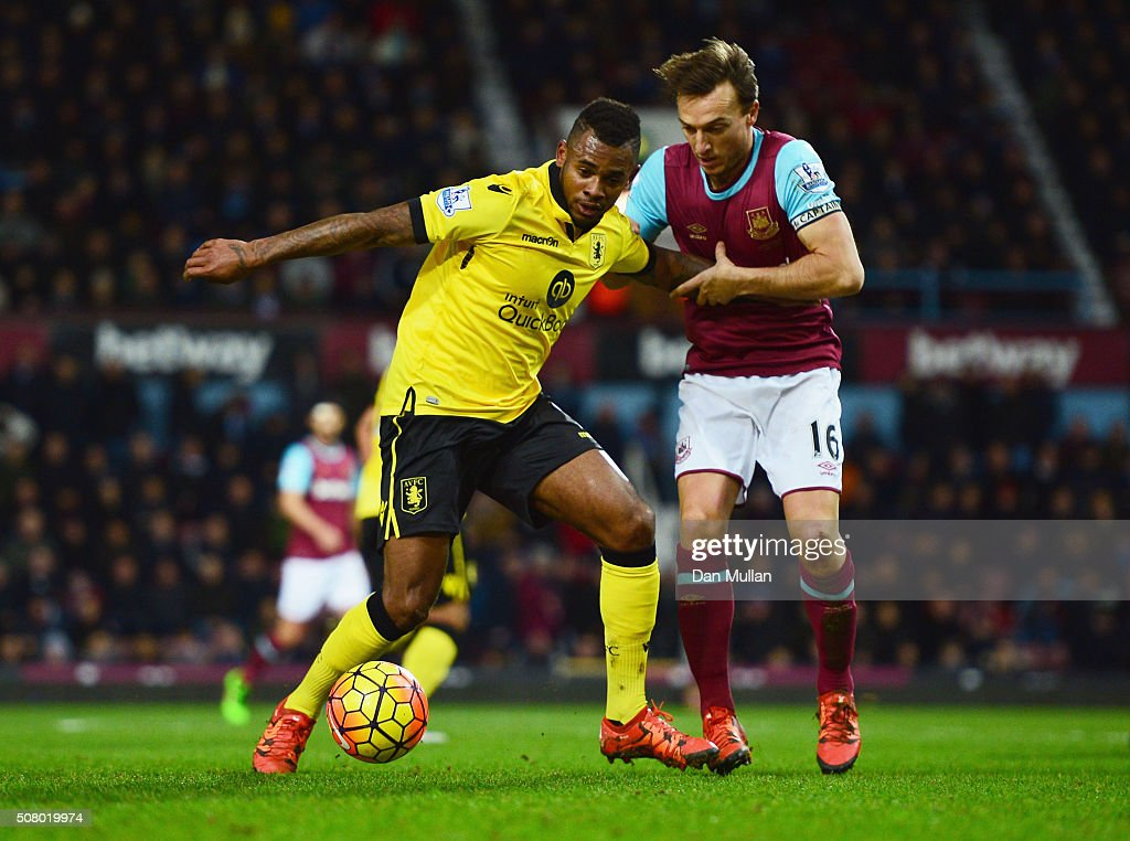 Leandro Bacuna of Aston Villa and Mark Noble of West Ham United compete for the ball during the Barclays Premier League match between West Ham United and Aston Villa at the Boleyn Ground on February 2, 2016 in London, England.