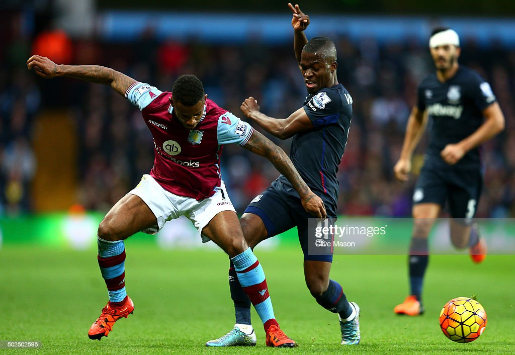 Leandro Bacuna of Aston Villa battles for the ball with Enner Valencia of West Ham United during the Barclays Premier League match between Aston Villa and West Ham United at Villa Park on December 26, 2015 in Birmingham, England.