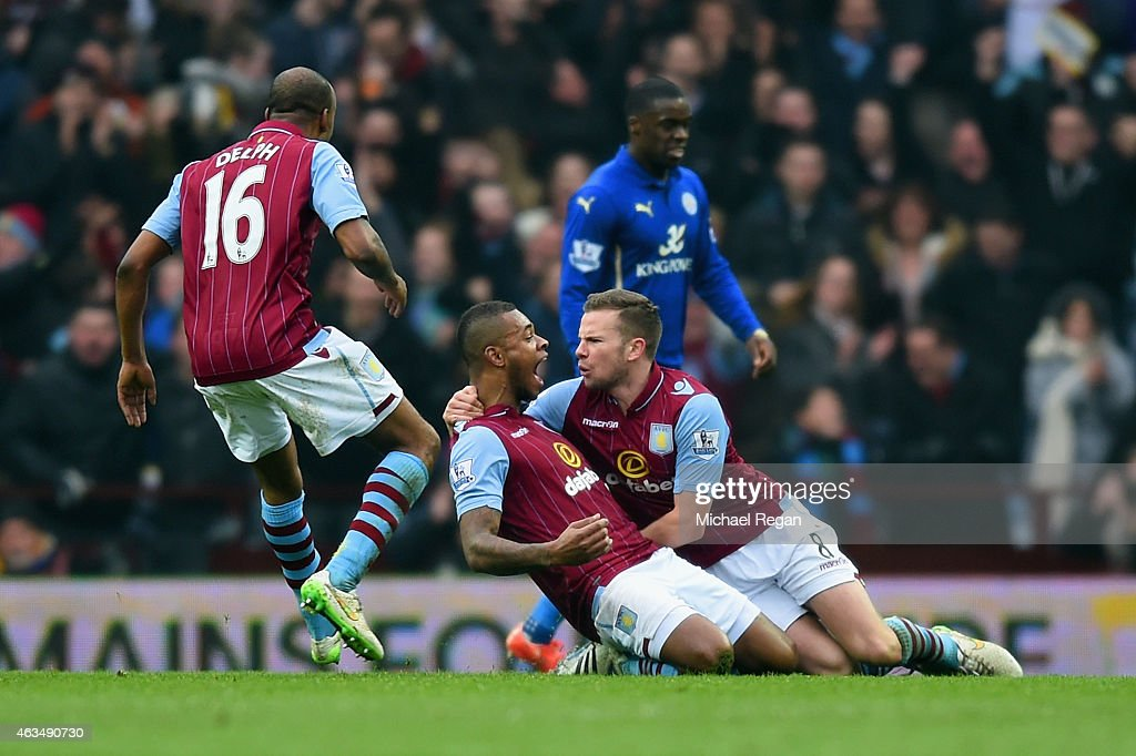 Leandro Bacuna of Aston Villa celebrates scoring the opening goal with Tom Cleverley (R) snd Fabian Delph of Aston Villa during the FA Cup fifth round match between Aston Villa and Leicester City at Villa Park on February 15, 2015 in Birmingham, England.