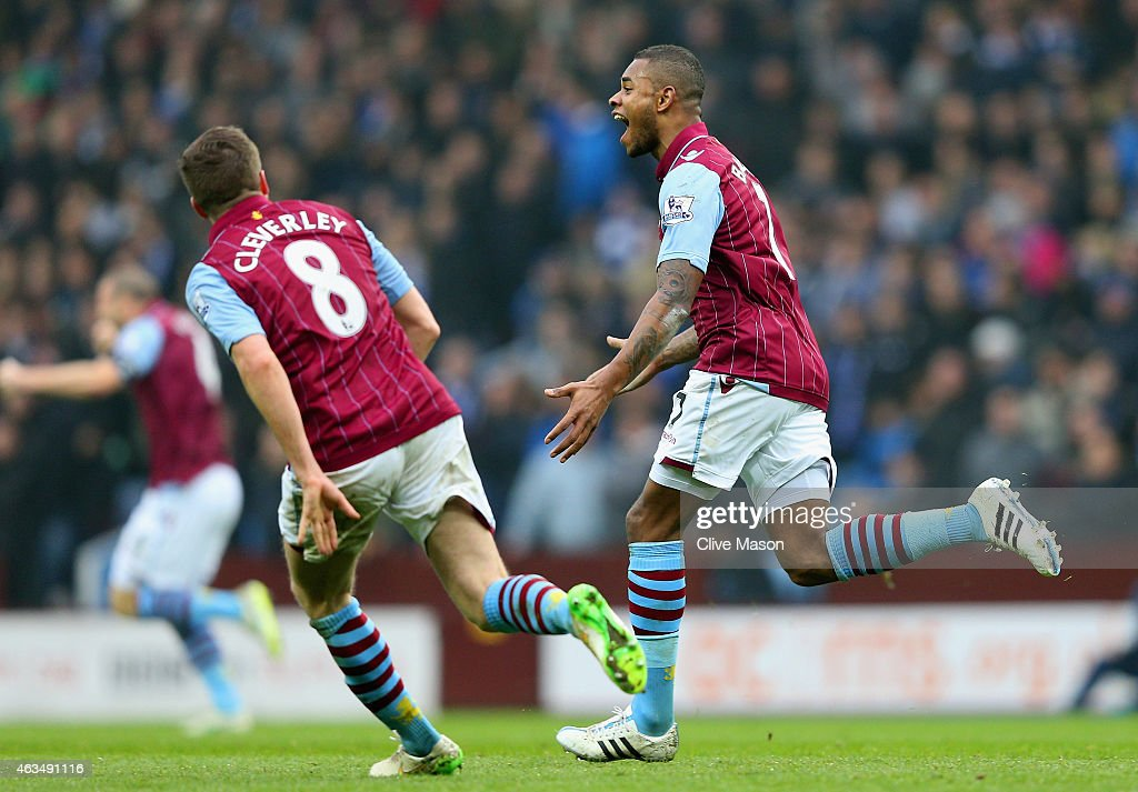 Leandro Bacuna of Aston Villa celebrates scoring the opening goal with Tom Cleverley of Aston Villa during the FA Cup fifth round match between Aston Villa and Leicester City at Villa Park on February 15, 2015 in Birmingham, England.