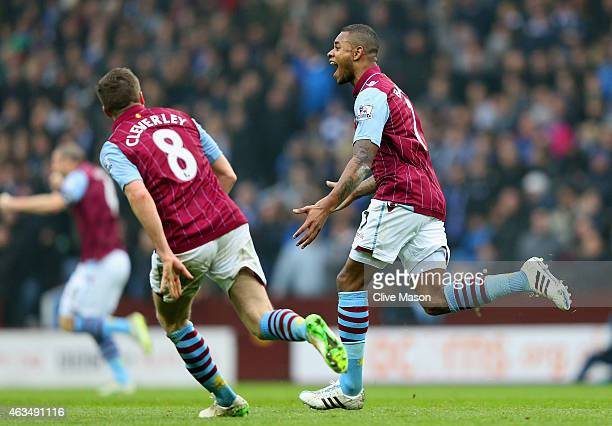 Leandro Bacuna of Aston Villa celebrates scoring the opening goal with Tom Cleverley of Aston Villa during the FA Cup fifth round match between Aston...