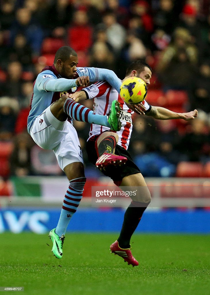 Leandro Bacuna of Aston Villa challenges Phil Bardsley of Sunderland during the Barclays Premier League match between Sunderland and Aston Villa at Stadium of Light on January 1, 2014 in Sunderland, England.