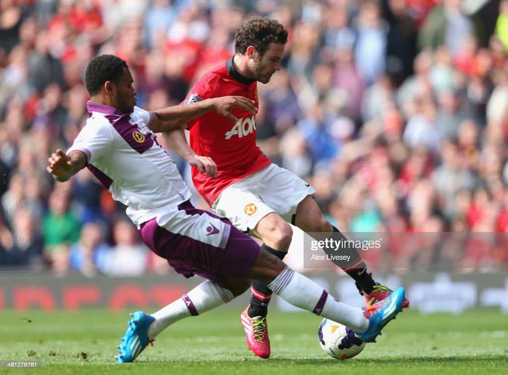 Leandro Bacuna of Aston Villa fouls Juan Mata of Manchester United to concede a penalty kick during the Barclays Premier League match between Manchester United and Aston Villa at Old Trafford on March 29, 2014 in Manchester, England.