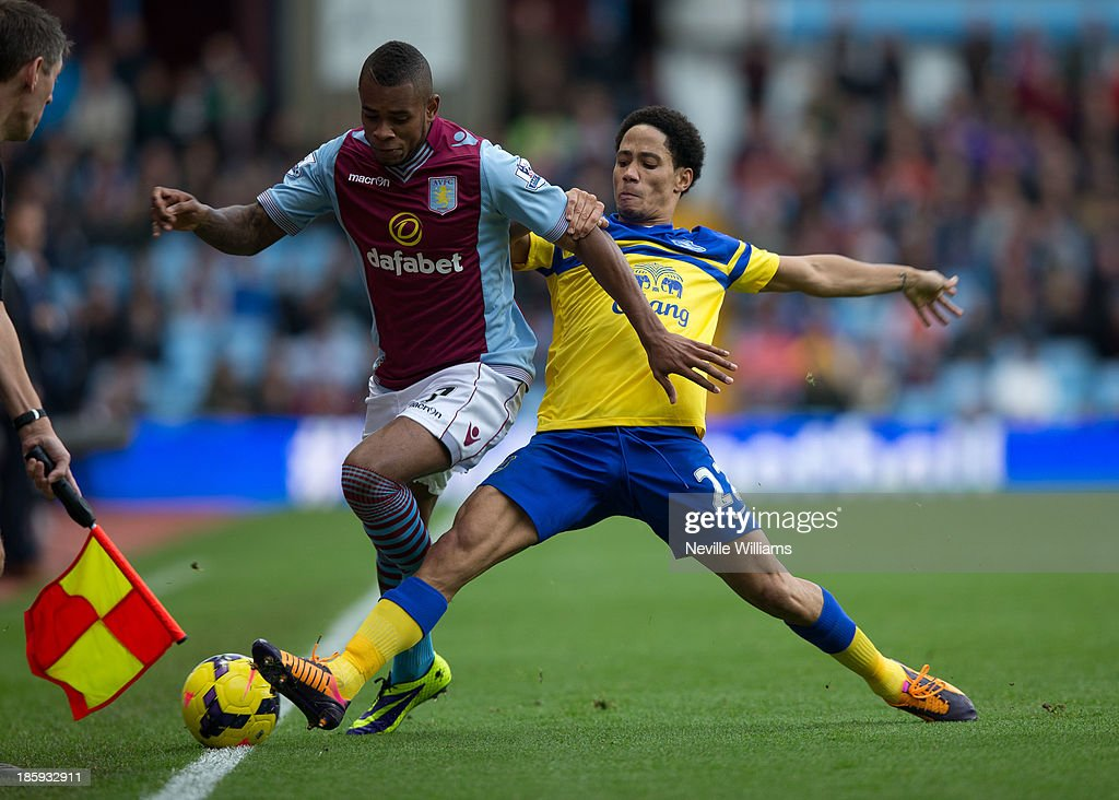 Leandro Bacuna of Aston Villa (L) is challenged by <a gi-track='captionPersonalityLinkClicked' href=/galleries/search?phrase=Steven+Pienaar&family=editorial&specificpeople=787271 ng-click='$event.stopPropagation()'>Steven Pienaar</a> of Everton during the Barclays Premier League match between Aston Villa and Everton at Villa Park on October 26, 2013 in Birmingham, England.