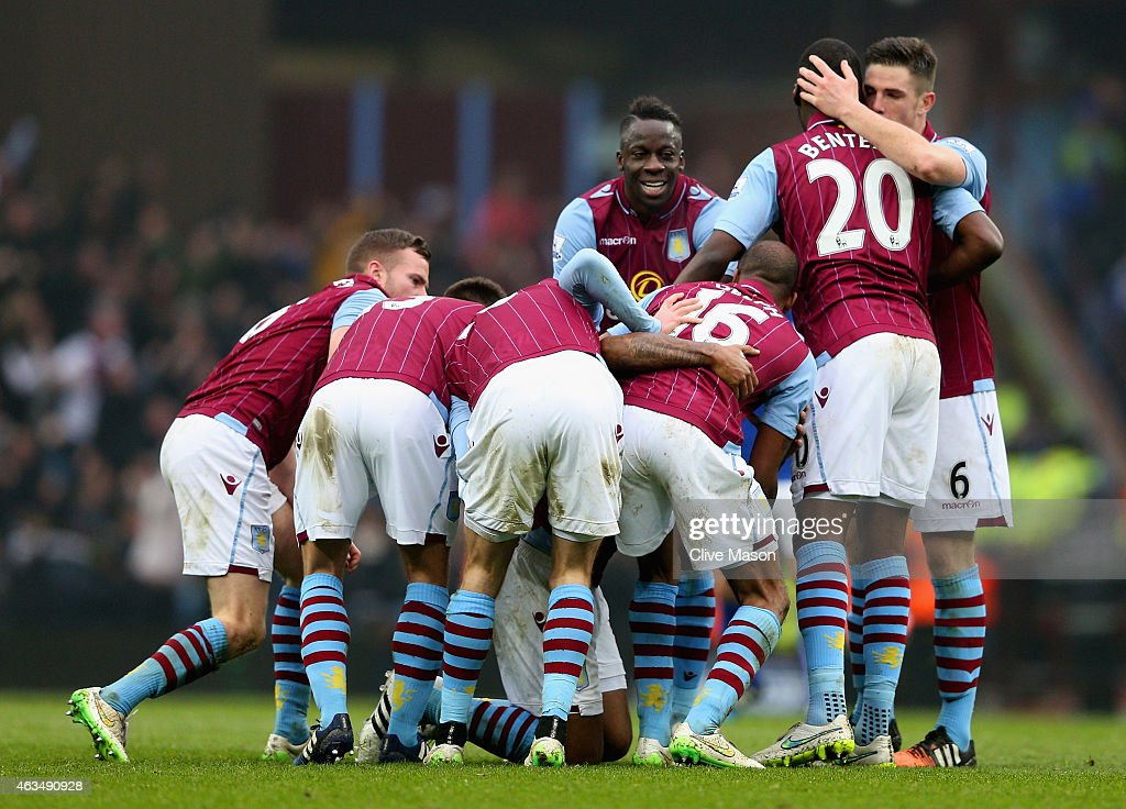 Leandro Bacuna of Aston Villa is mobbed by team mates as he celebrates scoring the opening goal during the FA Cup fifth round match between Aston Villa and Leicester City at Villa Park on February 15, 2015 in Birmingham, England.