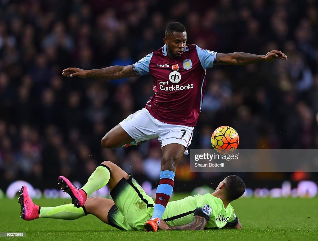 Leandro Bacuna of Aston Villa is tackled by Aleksandar Kolarov of Manchester City during the Barclays Premier League match between Aston Villa and Manchester City at Villa Park on November 8, 2015 in Birmingham, England.