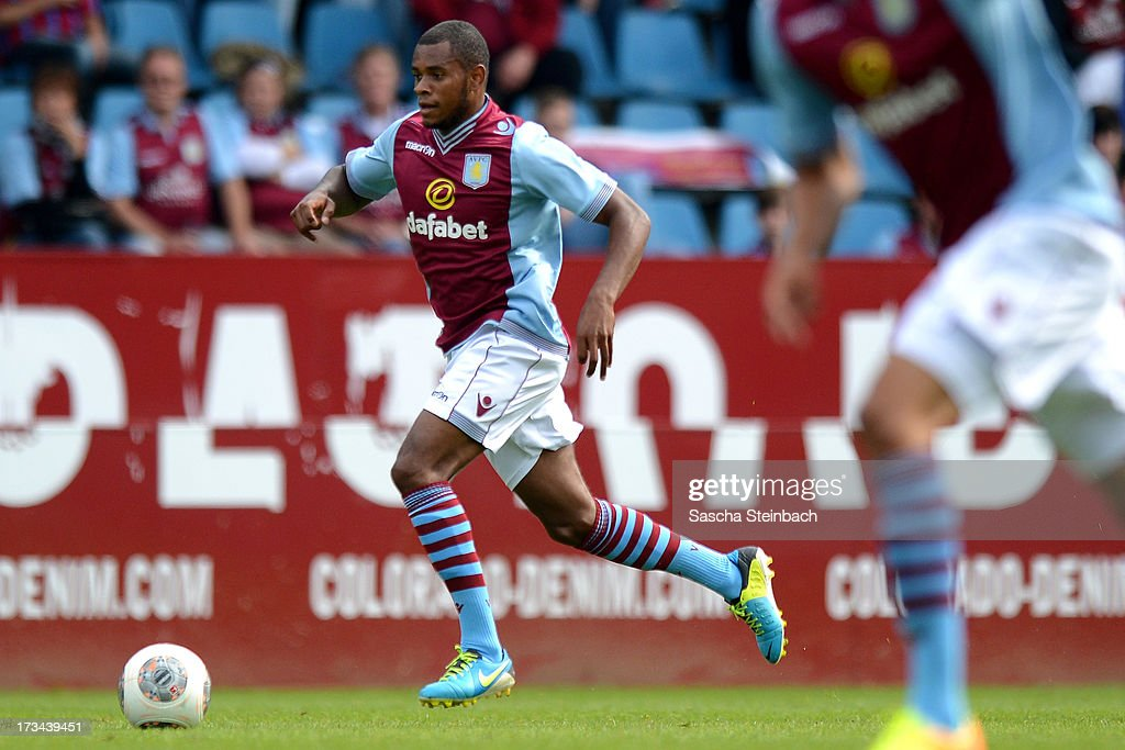 Leandro Bacuna of Aston Villa runs with the ball during the pre-season friendly match between VfL Bochum and Aston Villa at Rewirpower Stadium on July 14, 2013 in Bochum, Germany.