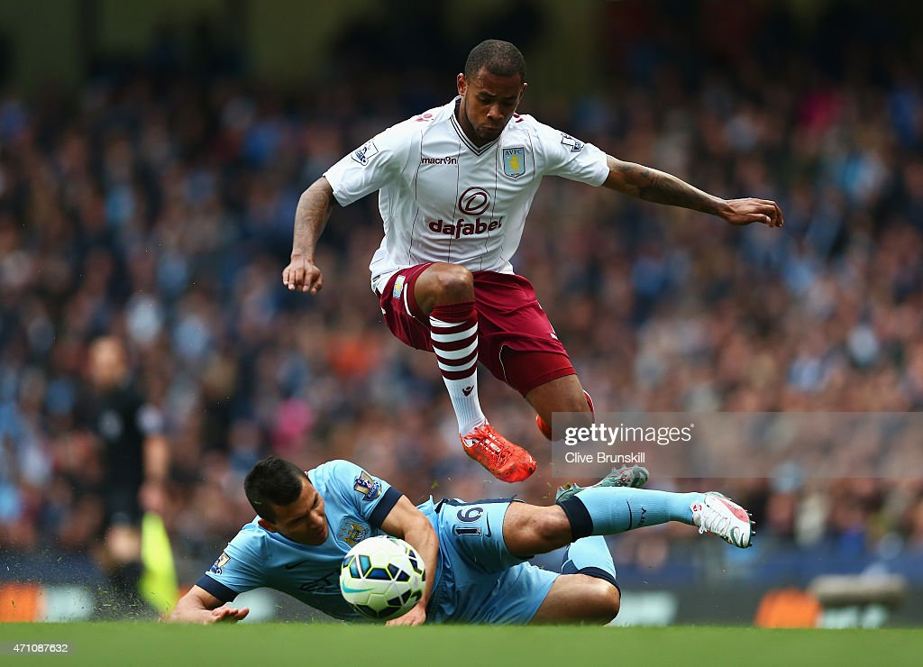 Leandro Bacuna of Aston Villa skips a challenge from Sergio Aguero of Manchester City during the Barclays Premier League match between Manchester City and Aston Villa at Etihad Stadium on April 25, 2015 in Manchester, England.