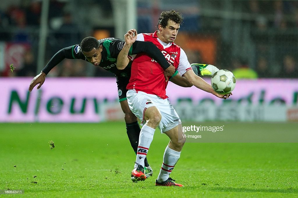 Leandro Bacuna of FC Groningen, Dirk Marcellis of AZ during the Dutch Eredivisie match between AZ Alkmaar and FC Groningen at the AFAS Stadium on february 2, 2013 in Alkmaar, The Netherlands