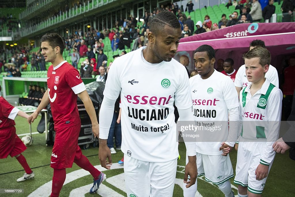 Leandro Bacuna of FC Groningen with special shirt for father of Luciano during line up during the Eredivisie Europa League Playoff match between FC Groningen and FC Twente on May 16, 2013 at the Euroborg stadium at Groningen, The Netherlands.