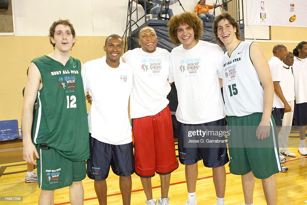 Leandro Barbosa and Shawn Marion of the Phoenix Suns,and Anderson Varejao of the Cleveland Cavaliers take a photo with some campers at the Pinheiros Sports Club during Basketball Without Borders on August 3, 2007 in Sao Paulo, Brazil.