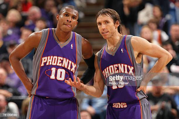 Leandro Barbosa and Steve Nash of the Phoenix Suns talk strategy during the game against the Sacramento Kings at ARCO Arena November 20 2007 in...