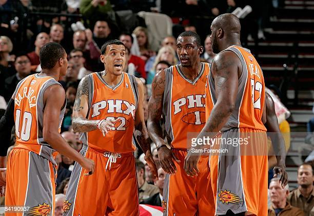 Leandro Barbosa Matt Barnes Amar'e Stoudemire and Shaquille O'Neal of the Phoenix Suns huddle on the court during the game against the Portland Trail...