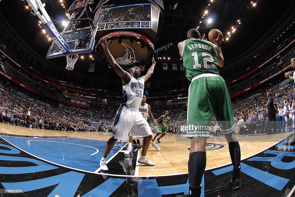 Leandro Barbosa #12 of the Boston Celtics aims over E'Twaun Moore #55 of the Orlando Magic during the game between the Boston Celtics and the Orlando Magic on November 25, 2012 at Amway Center in Orlando, Florida.