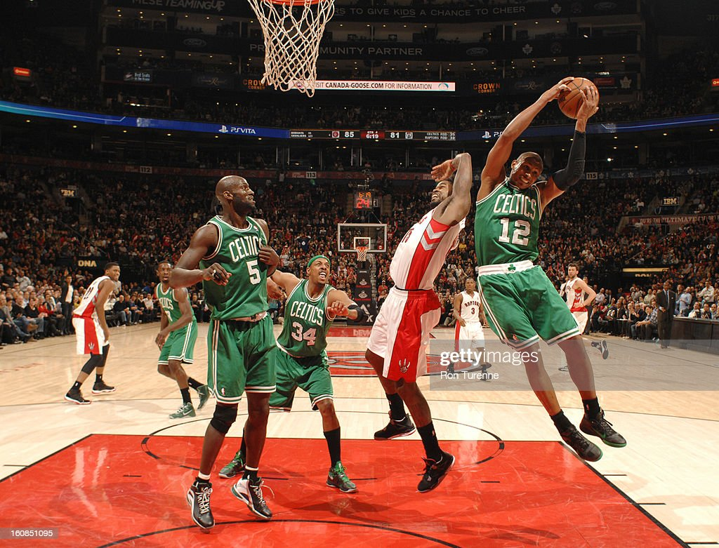 Leandro Barbosa #12 of the Boston Celtics handles the ball against Amir Johnson #15 of the Toronto Raptors during the game between the the Toronto Raptors and the Boston Celtics on February 6, 2013 at the Air Canada Centre in Toronto, Ontario, Canada.