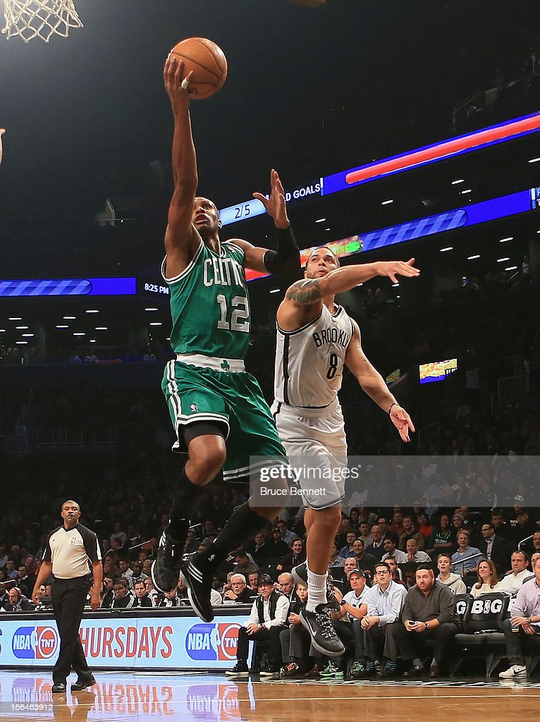 Leandro Barbosa #12 of the Boston Celtics misses the shot as he flies past Deron Williams #8 of the Brooklyn Nets at the Barclays Center on November 15, 2012 in the Brooklyn borough of New York City.