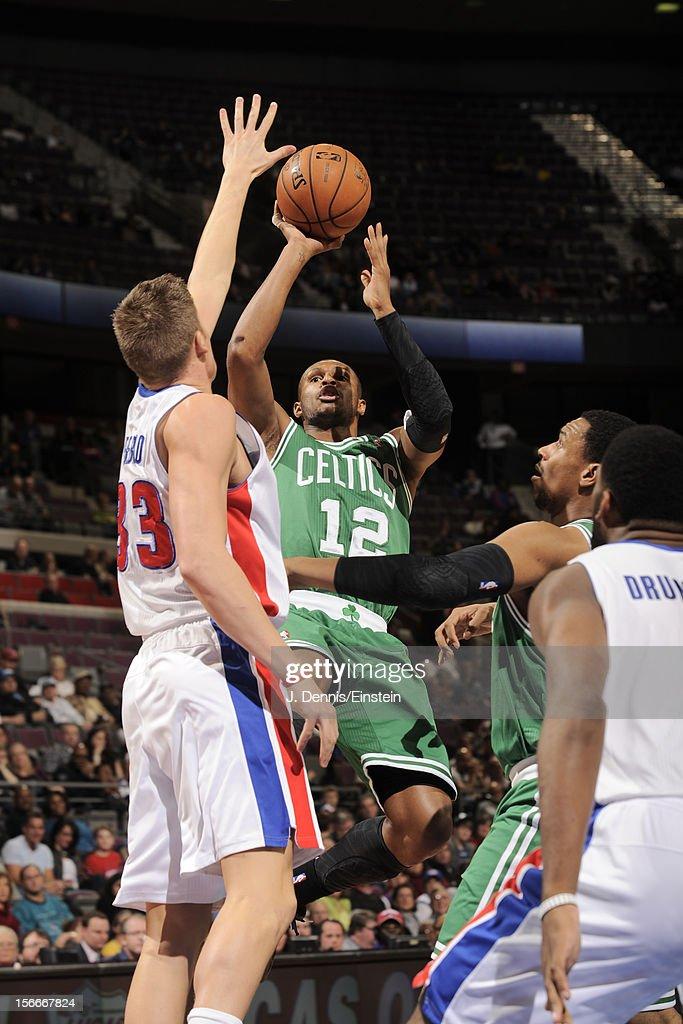 Leandro Barbosa #12 of the Boston Celtics shoots against Jonas Jerebko #33 of the Detroit Pistons on November 18, 2012 at The Palace of Auburn Hills in Auburn Hills, Michigan.