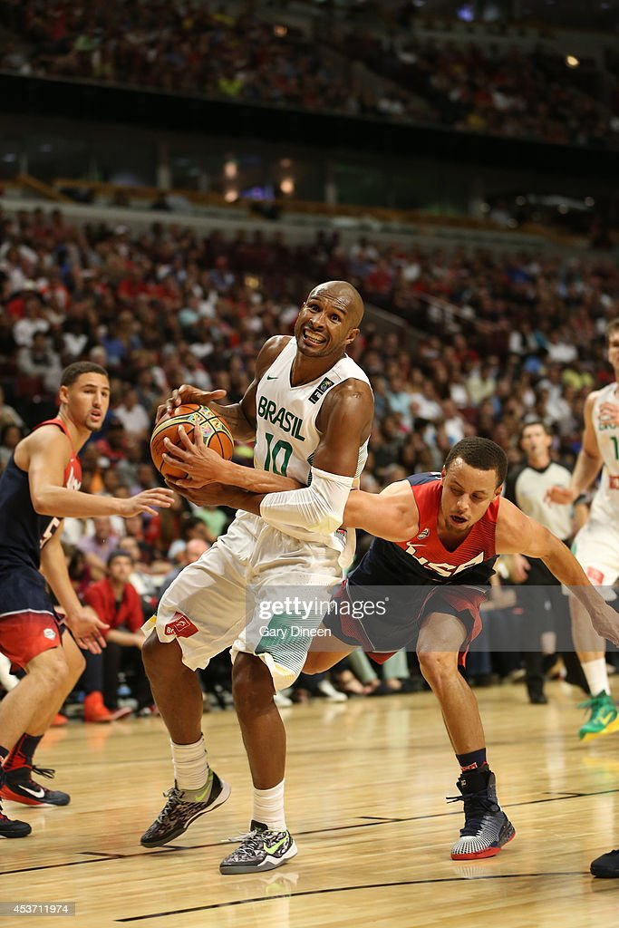 <a gi-track='captionPersonalityLinkClicked' href=/galleries/search?phrase=Leandro+Barbosa&family=editorial&specificpeople=201506 ng-click='$event.stopPropagation()'>Leandro Barbosa</a> #10 of the Brazil National Team drives against <a gi-track='captionPersonalityLinkClicked' href=/galleries/search?phrase=Stephen+Curry+-+Basketball+Player&family=editorial&specificpeople=5040623 ng-click='$event.stopPropagation()'>Stephen Curry</a> #4 of the USA Basketball Men's National Team on August 16, 2014 at the United Center in Chicago, Illinois.