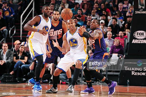 Leandro Barbosa of the Golden State Warriors and Eric Bledsoe of the Phoenix Suns reach for a loose ball on March 9 2015 at US Airways Center in...